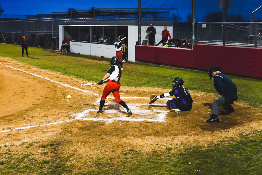A+Redhawk+softball+player+swings+at+home+plate+at+a+game+against+Independence.+The+softball+team+plays+Lebanon+Trail+at+home+at+6%3A30+p.m.