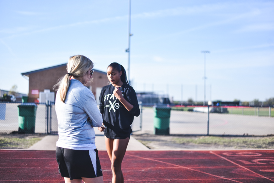 With+girls%27+head+track+coach+Amanda+Zambiasi+looking+on%2C+senior+Nissi+Kabongo+prepares+for+the+Texas+Relays+at+UT+Austin+on+Friday+and+Saturday.+