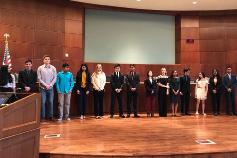 Redhawk National Merit Semifinalists from 2019 stand during a recognition ceremony during Monday night