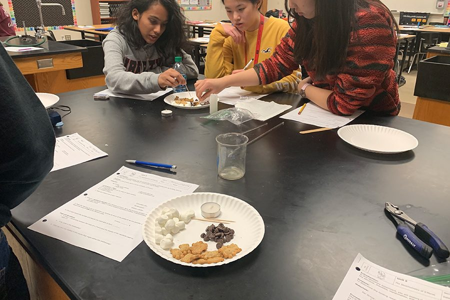 Chemistry+students+are+making+s%27mores+in+class+on+Thursday+and+Friday+as+part+of+their+new+unit+on+stoichiometry.+The+activity+allows+students+to+get+a+visual+representation+of+the+chemistry+they+are+learning+and+helps+students+understand+the+concepts+of+the+class.