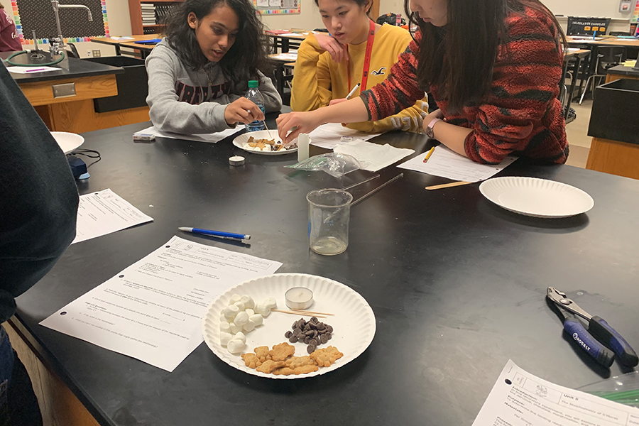 Chemistry students are making s'mores in class on Thursday and Friday as part of their new unit on stoichiometry. The activity allows students to get a visual representation of the chemistry they are learning and helps students understand the concepts of the class.