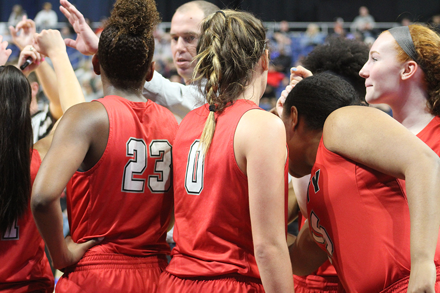 During+a+break+in+the+action%2C+the+team+huddles+up+on+the+sideline+in+the+5A+state+semifinal+against+Kerrville+Tivy+in+the+Alamodome.+The+Redhawks+scored+a+34-28+win+to+advance+to+Saturday%27s+state+final.+