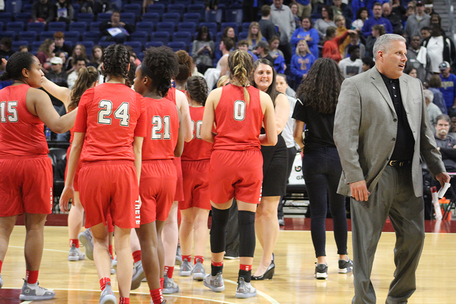 Campus+athletic+director+Chris+Burtch+walks+away+from+the+team+after+the+Redhawks+34-28+win+the+UIL+5A+state+semifinal+against+Kerrville+Tivy.+The+team+went+more+than+12+minutes+without+scoring+but+never+gave+up+the+lead.+