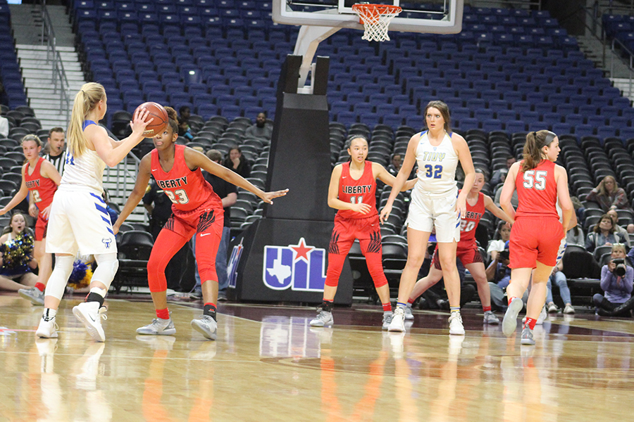 Trying+to+get+the+ball+into+center+Catherine+Kaiser+%28%2332%29%2C+Tivy+guard+Charli+Becker+%28%2311%29+is+guarded+by+Redhawks+senior+Randi+Thompson.+The+Redhawks+offense+sputtered+at+times%2C+going+more+than+12+minutes+without+scoring%2C+but+their+defense+never+allowed+the+Antlers+to+take+a+lead.++