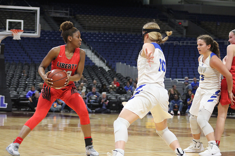 Guarded+by+Tivy%27s+Julia+Becker+%28%2310%29%2C+senior+Randi+Thompson+looks+to+make+a+move+in+the+5A+state+semifinal+game+at+the+Alamodome+in+San+Antonio.+Thompson+would+finish+with+a+game+high+16+points+and+six+steals+in+the+Redhawks+34-28+win.+