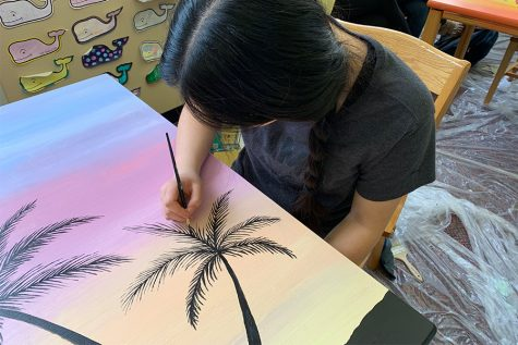 Tables become canvas for library painting project
