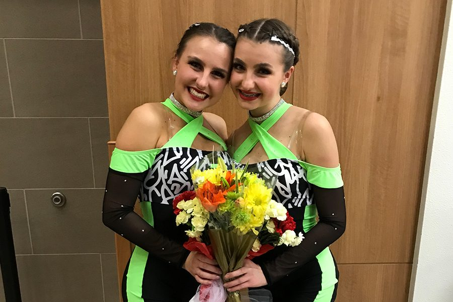 Posing after a competition, sisters Emily and Kelsey Madden have united with dance both participating in Red Rhythm. Emily, being a senior, has gotten a chance to show her freshman sister the ins and outs of Red Rhythm.