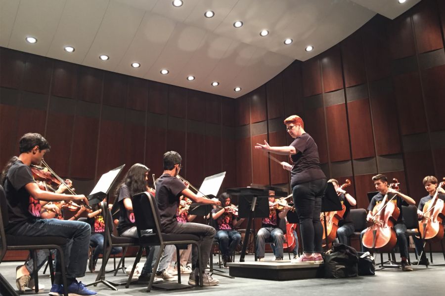 Orchestra+director+Julie+Blackstock+conducts+one+of+two+Redhawk+ensembles+that+performed+at+the+Eisemann+Center+on+the+morning+of+Friday%2C+April+5.+Students+then+returned+to+campus+before+leaving+for+South+Padre+on+their+annual+spring+trip.+