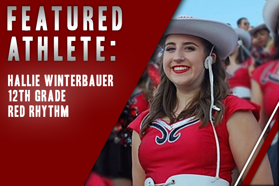 Senior Hallie Winterbauer smiles at a football game as part of Red Rhythm. For Winterbauer, the relationships and people in drill team are her favorite part of Red Rhythm.