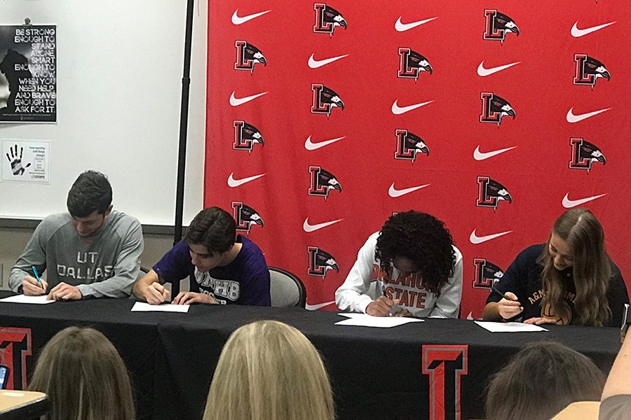 Seniors CJ Nelson, Gavin Clark, Sanye Ford, and Ashley Pennington (left to right) signed on to continue their athletic careers in college on Friday Morning in the lecture hall.