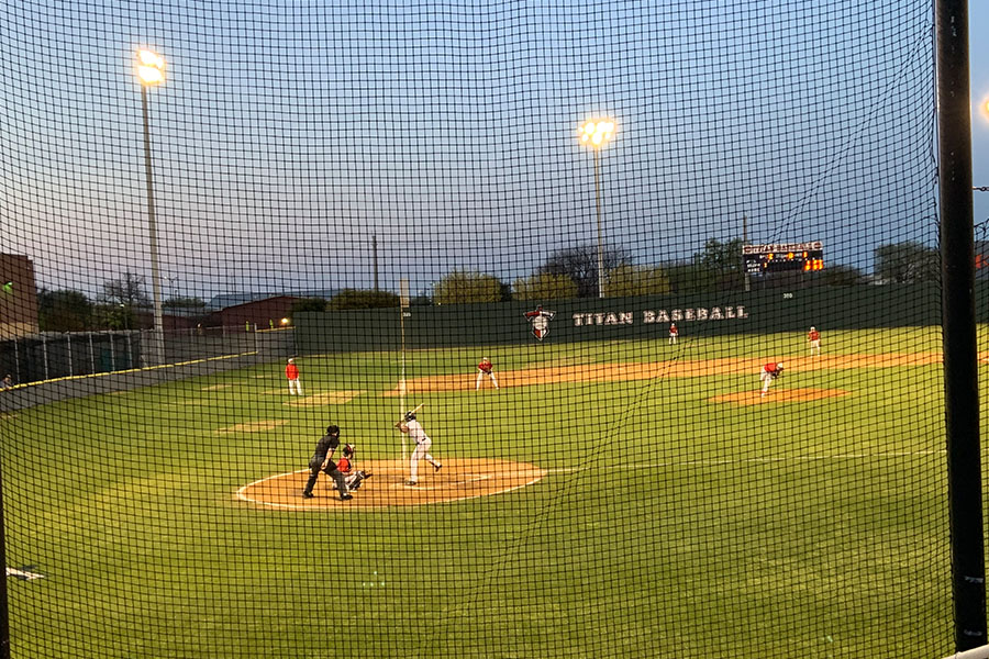 The Redhawks are batting against the Centennial Titans in a game last season. Baseball, along with other sports will no longer require a fee to participate.