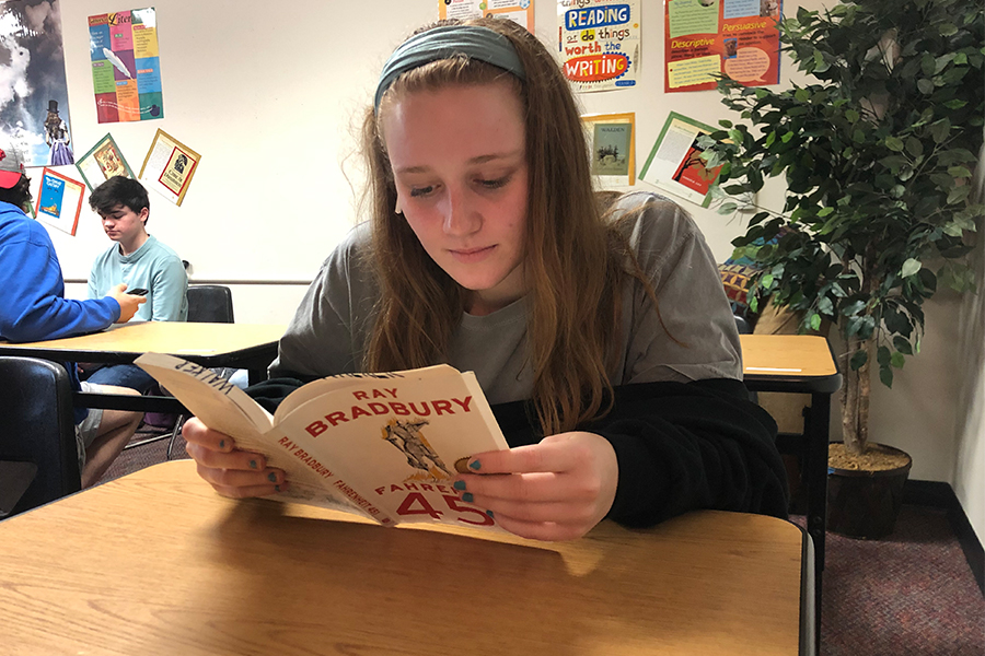 Senior Olivia Brucker reads the book, Fahrenheit 451 by Ray Bradbury. Students in AP lit are doing a project based on a book of their choosing for the next several weeks.