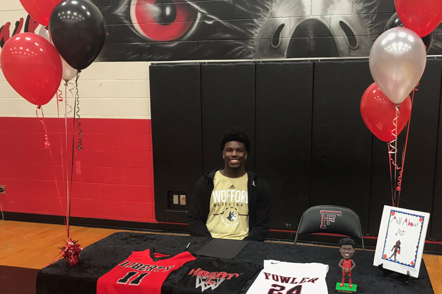 With+his+past+jerseys+displayed+on+the+table+in+front+of+him%2C+senior+Zion+Richardson+announced+his+commitment+to+Wofford+College+where+he+will+continue+his+basketball+career.+Richardson+announced+his+decision+Friday+at+Fowler+Middle+with+Campbell+and+Western+Michigan+his+other+two+finalists.