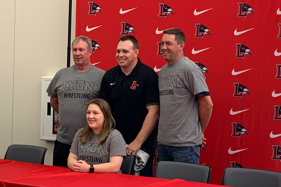 Wrestling athlete Ashley Cook signed a National Letter of Intent to continue her athletic career at Lyon College at a Signing Day Ceremony Wednesday in the library.