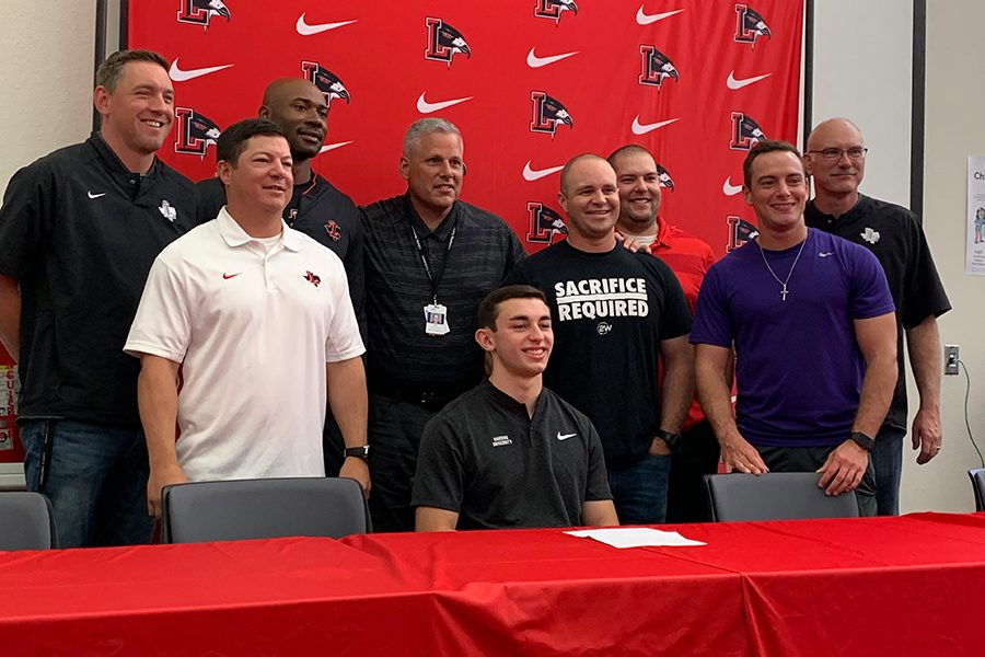 Track+and+field+athlete+Andrew+Ashmore+signed+a+National+Letter+of+Intent+to+continue+his+athletic+career+at+Harding+University+at+a+Signing+Day+Ceremony+Wednesday+in+the+library.