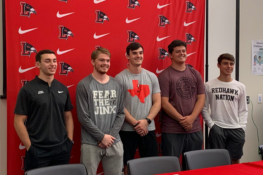 Football+athlete+Dalton+Stewart+signed+a+National+Letter+of+Intent+to+continue+his+athletic+career+at+Southwestern+College+at+a+Signing+Day+Ceremony+Wednesday+in+the+library.