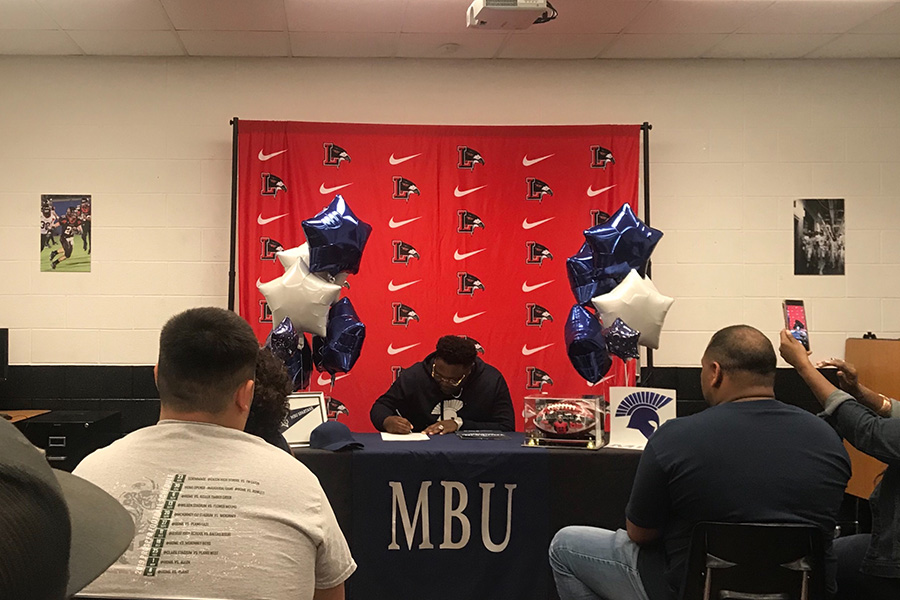 Football player Myron Huff signed to Missouri Baptist University to continue his athletic career next year during a Signing Day Ceremony in the fieldhouse classroom on Wednesday. Huff believes this opportunity will allow him to improve his play while experiencing a new environment.