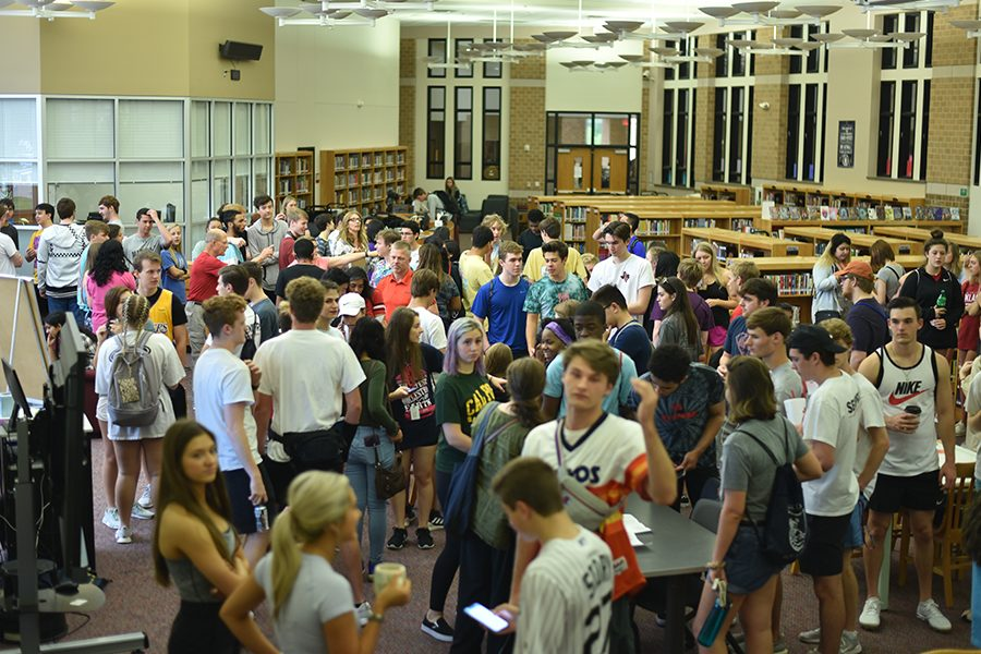 Seniors+gathered+in+the+library+early+Thursday+morning+before+boarding+busses+heading+to+Six+Flags.+Seniors+not+in+attendance+had+to+attend+school+as+normal+or+take+an+absence.