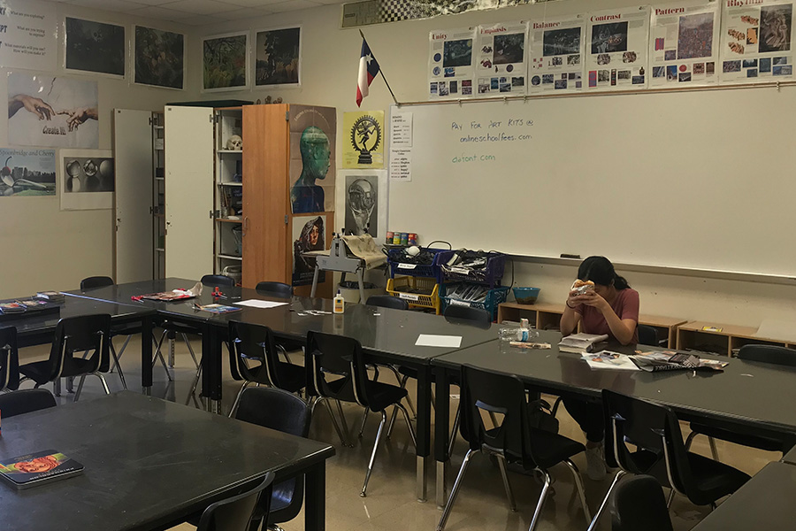 A student is working on a piece in art teacher Pernie Fallon's classroom. Fallon is back teaching AP Art History after the class died off years ago, now brought back by a wave of interested students.