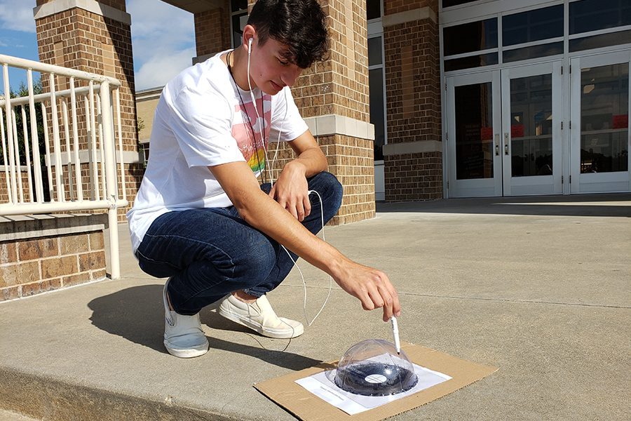 """While AP Human Geography and AP Biology students were inside, Astronomy students like senior Michael Torres spent part of class outside.   """"Astronomy is all about looking at patterns in the sky, the sun, moon, stars, Astronomy teacher Kenric Davies said. So you have to get out of the classroom in order to see the sky, so we do as much as you can."""