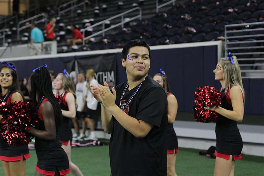 Joining+the+cheer+squad+during+his+junior+year%2C+senior+Andres+Venegas+is+the+only+male+cheerleader+alongside+his+16+teammates+on+campus.+