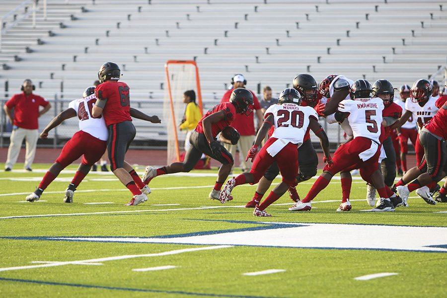 Redhawks secured the ball attempting to make it past North Garlands defenders on Friday, Aug. 30. at Memorial.