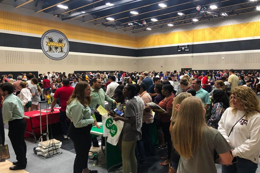 College+fair+was+Wednesday%2C+September+11th+at+Memorial+High+School.+Students+and+parents+broadened+their+knowledge+on+colleges+and+universities+as+they+got+to+meet+with+many+representatives.