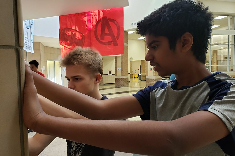 Standing outside the lecture hall, freshmen Dmithi Obideiko and Arjun Gnanavel discuss how to sketch out a map of the school as part of an AP Human Geography project on Wednesday, Sept. 11, 2019.