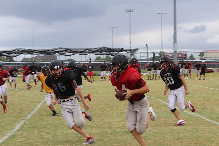 Looking to come out on top, the Redhawks work in practice to improve weaknesses shown in their last game. The team is tied with Memorial High School in District 7-5A but feel they have the upper hand.