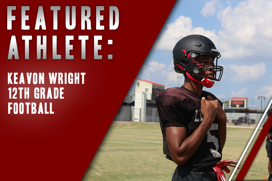 Varsity football, senior Keavon Wright listens during practice. Playing football all throughout high school, the NFL is end goal for Wright.