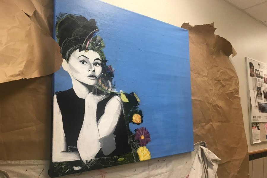Inspired+by+the+movie+Breakfast+at+Tiffany%E2%80%99s%2C+juniors+Emma+Varela+and+Nayel+Nasifa+decided+to+paint+Audrey+Hepburn+on+the+schools+open+canvas.+After+two+weeks+of+being+up+for+show%2C+the+canvas+will+be+given+to+the+next+painters+in+line.