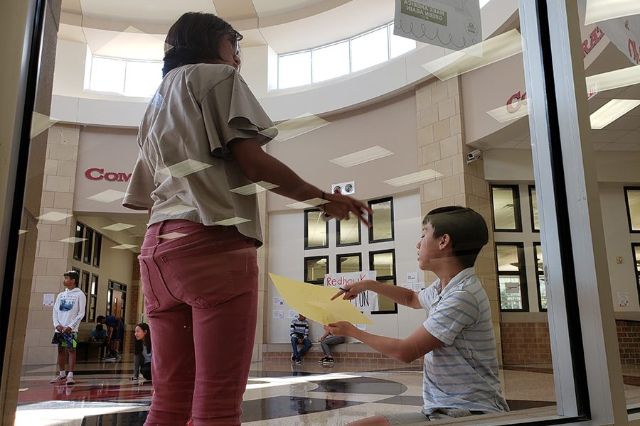 Working on their own project in the rotunda, AP Human Geography students, freshmen Samantha Umali and Nathan Chen map the school.