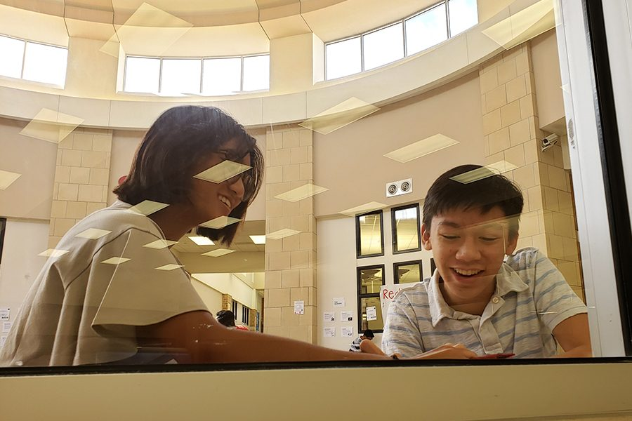 On the other side of the windows from the cafeteria, freshman Samantha Umali and Nathen Chen are utilizing their time outside of the classroom to learn about human geography in a new way by working in pairs to map the school.