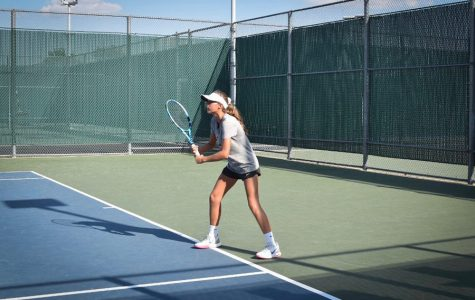 Sophomore Milla Dopson prepares during practices for upcoming matches. The tennis team heads to Centennial at 4:00 p.m. for the first match of the season.
