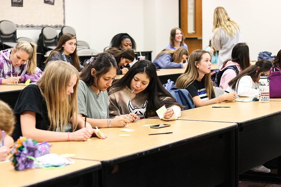 The lecture hall was filled with around 50 students, who were met with candy and prompted to write down compliments on sticky notes to give to their peers.