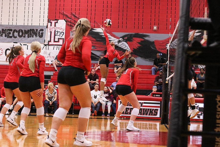 Protecting their first place title within District 9-5A, Redhawks crushed the Raccoons on Friday, Oct. 18, 2019, winning in just three sets.