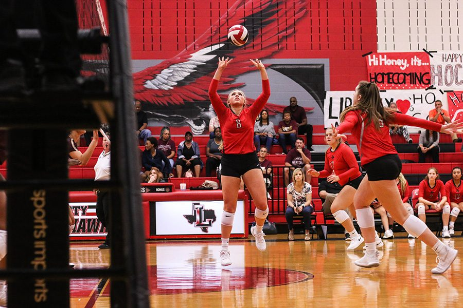 Senior Lauren Ransom sets the ball for her teammates to spike. The Redhawks take on Independence for the second time this season at 6:30 at the Nest.
