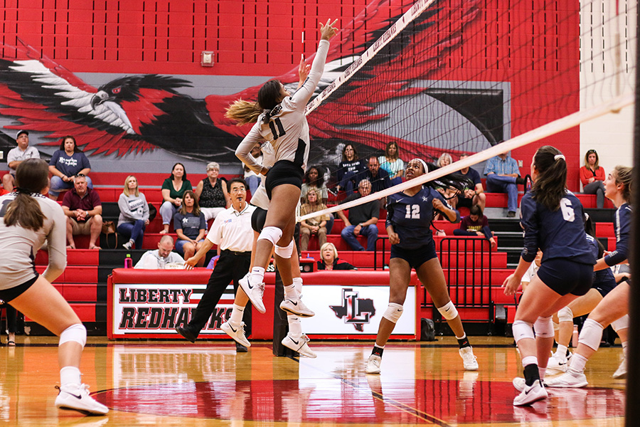 Sophomore Lauryn Hill puts up a block against the other team, in hopes of running a successful defense. The team is keeping up their winning streak, and hopes to continue the clean play for the rest of the season.