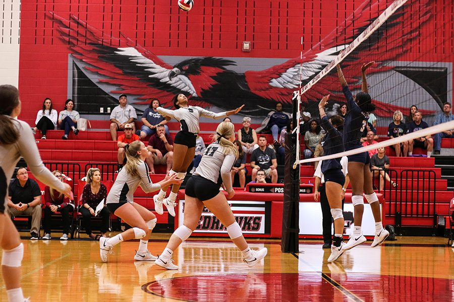 Volleyball prepares to spike the ball over the net in a match against Frisco High. The Redhawks play the Heritages Coyotes at 6:30 p.m. at home.