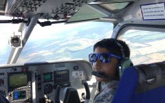 Freshman Akash Pradeep sits in the cockpit of an aircraft operated by the Civil Air Patrol. Pradeep fell in love with flying as a scout in Virginia.