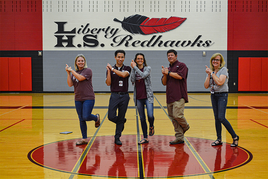 Texas A&M alumni math teacher Amber Bennett, biology teacher Chris Ham, counselor Lindsay Pfiffner, football coach David Gonzales, and medical terminology teacher Laura Stubblefield show their Aggie pride in The Nest. As the early application deadline for both schools approaches Nov. 1, faculty give students their insight.