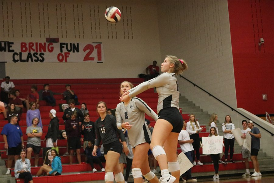In her second game as a varsity player, Frishman Mckenna Gildon passes the ball in hopes of holding off Independence. The team took the Knights down in three sets, and hopes that the rest of the season is as clean as their previous games.