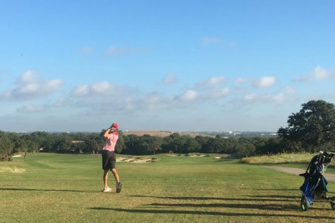 Teeing off at the first hole at the Texas Rangers Golf Course, senior Jack Day drives the ball down the fairway on the par 5 hole.
