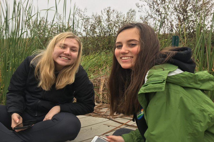 Senior Natalie Brooks and Sydney Zornig, both AP Environmental students, visit the John Bunker Sands Wetlands in Seagoville on Tuesday. Students had the chance to learn about water use in the DFW area and ultimately how to conserve it.