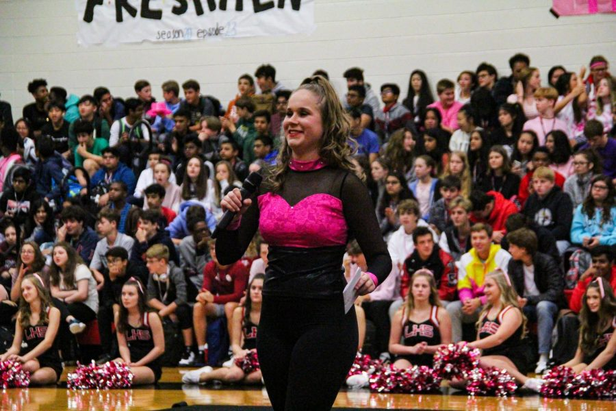In addition to being part of Red Rhythm, senior Emma Hancock is also the Student Council president which means she has double duty at pep rallies where she performs with Red Rhythm and also helps lead the pep rally.