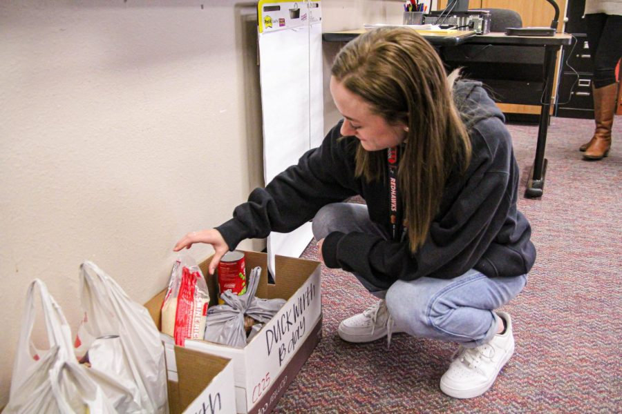 With the canned food drive ending Thursday, Junior Emma Gow puts in her last minute donations. All donations will help families in need through Frisco Family Services.