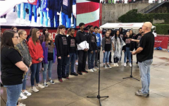 A change of scenery, choir sings at Texas Legends game