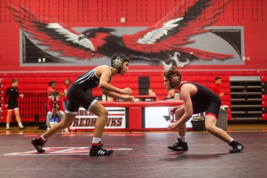 Freshmen Eric Corona and Devon Hlavenka begin their dual during the annual Red vs. Black scrimmage on Saturday, Nov. 9, 2019. With wrestlers split into two teams, coach Bridwell and his wrestlers took the victory.