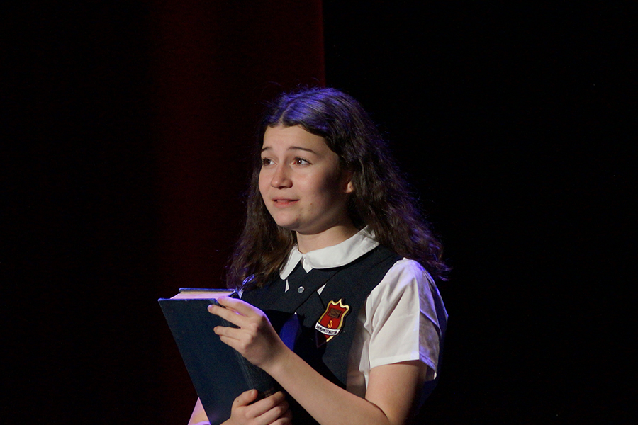 In the title role of Matilda, sophomore Jane Wester sings in the opening act. Students have been preparing for the musical since August, however, after the show completed, many students found themselves catching up on missed school work.
