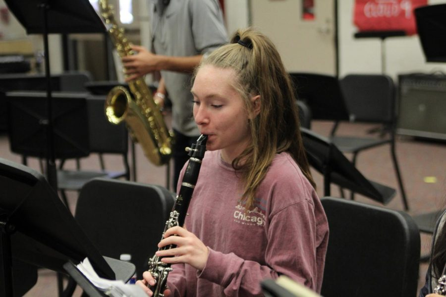 Senior Lindsey Jobe practices playing her instrument in the band hall. She is preparing for All Region auditions, which takes place for all band members Saturday at Plano Senior High School.
